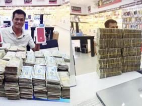 """Chàng trai Việt gây sốt khi mang """"núi"""" tiền lẻ đi mua iPhone 7 đỏ"""